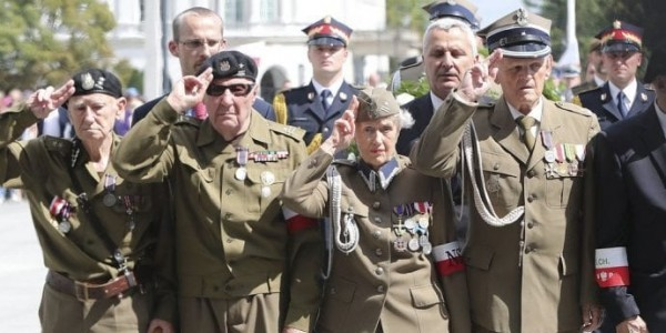 Polish president, ruling party officials pay tribute to wartime force in pitch to right-wing voters; country's chief rabbi calls ceremony 'dangerous' historical revisionism