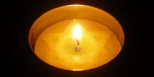 Płomiń na tle Gwiazdy Davida